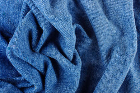towelling: Abstract artistic background of wrinkled blue fabric