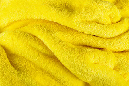 snugly: Yellow abstract wavy soft fabric background