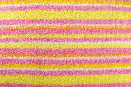 beach wrap: Stripy yellow terry towel close up surface pattern detail