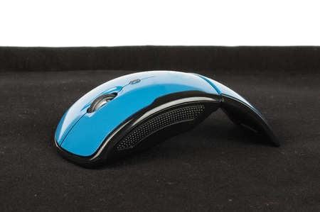 Blue wireless computer mouse on the black background Stock Photo
