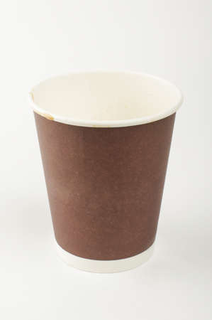 insulated drink container: Empty paper cup for hot drinks isolated on the white background Stock Photo