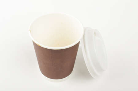 Paper coffee cup with open lid isolated on the white background