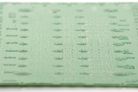 layer mask: Electronics PCB with green peelable solder mask low angle Stock Photo
