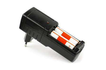nimh: Black AA batteries charger isolated on the white background