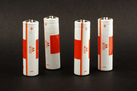 electrochemical: Four AA batteries isolated on the black background