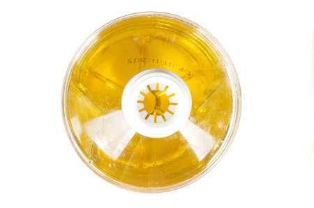 sunflower oil: Abstract photography top view of plastic extra virgin sunflower oil bottle isolated Stock Photo