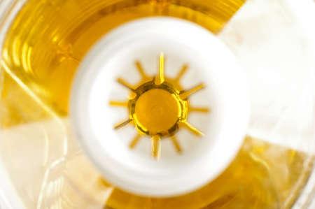 sunflower oil: Abstract photography of inside plastic sunflower oil bottle focus on oil Stock Photo