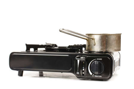 picknic: Portable gas stove isolated on white background low angle Stock Photo