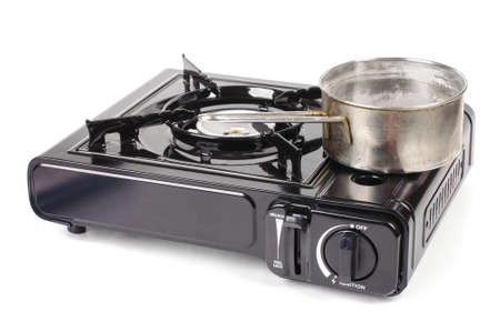 Portable gas stove with pot isolated on white background