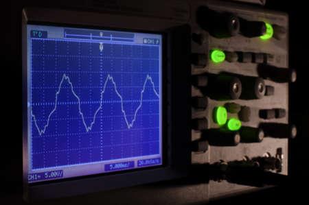 oscilloscope: Oscilloscope at night concept with deep shadows Archivio Fotografico