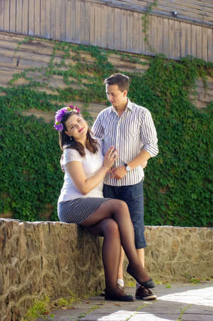 chatty: Young couple flirting outdoors with strong backlight