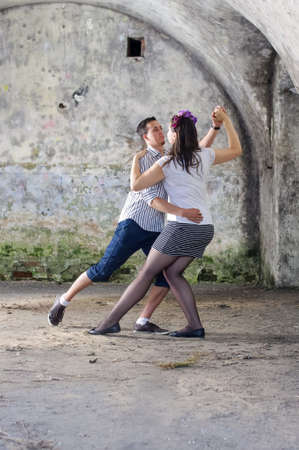 sexual activities: Young lovers dance in the moldy old castle Stock Photo