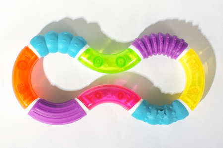 teether: Baby toy and teether isolated on bright background Stock Photo