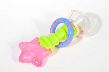 teether: Baby rattle with teether isolated on the white background