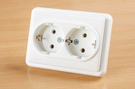 receptacle: Wall AC outlet panel receptacle isolated on the wooden background