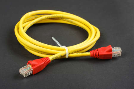 cat5: Ethernet cable isolated on the dark background Stock Photo