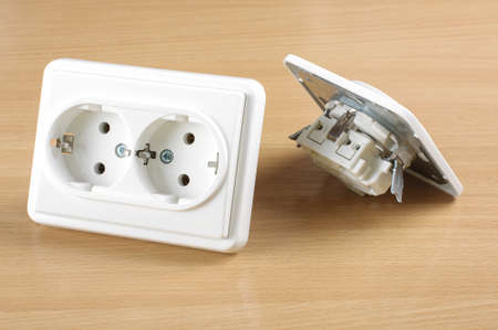 ac: Wall AC outlet panel receptacle isolated on the wooden background