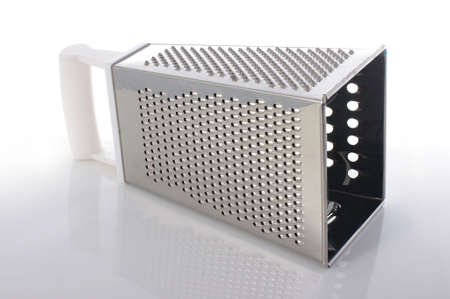 metal grater: Box grater with multiple grating surfaces isolated on the white background Stock Photo