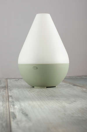 humidifier: Air humidifier on the aged wooden background