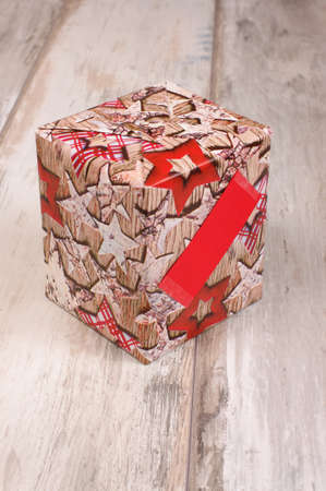 reclaimed: Wrapped gift box isolated on the reclaimed wood background Stock Photo