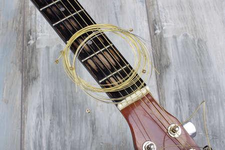 hertz: Guitar strings on the reclaimed wooden background