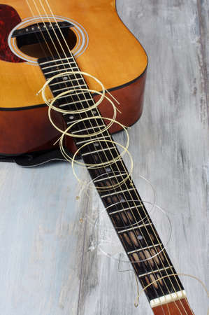 reclaimed: Guitar strings on the reclaimed wooden background