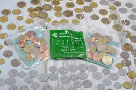 Euro starter kit bags surrounded by Litas and Centas coins old Lithuania currency replaced by euro