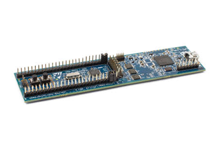 pcb: Photo of 32-bit microprocessor LPC1114 programmer and evaluation board PCB Stock Photo