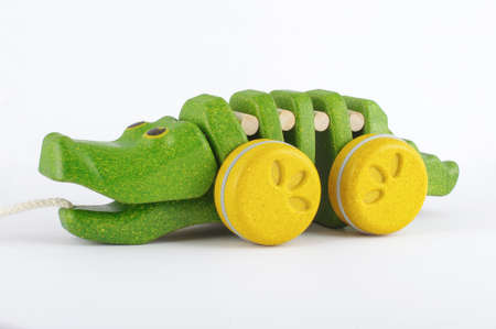 pull toy: Pull along organic wooden alligator toy isolated on the white background