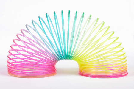Classical slinky spring toy isolated on the white background Standard-Bild