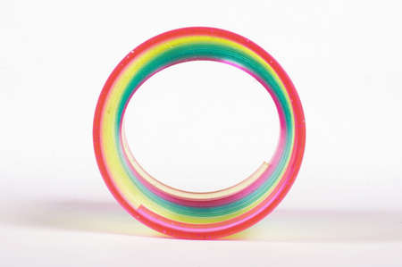 slinky: Abstract of classical slinky spring toy isolated on the white background