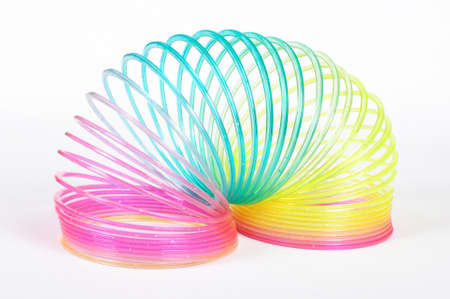 slinky: Classical slinky spring toy isolated on the white background Stock Photo