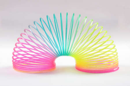 Classical slinky spring toy isolated on the white background Stock Photo