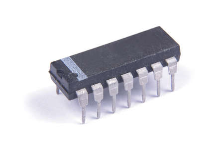 Integrated circuit in DIP package isolated on the white background Banco de Imagens