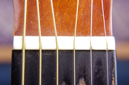 fretboard: Macro close up of used dusty guitar fretboard Stock Photo