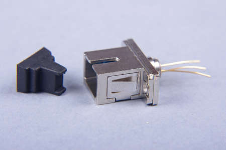 fiber optics: Fiber optics receiver photodiode isolated on the gray background Stock Photo