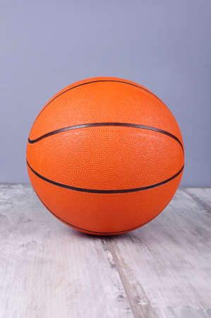 reclaimed: Basketball ball isolated on the reclaimed wood floor