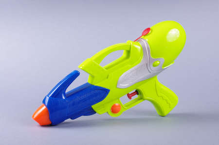 water gun: Water gun toy isolated on the gray background