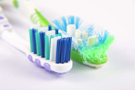 replacement: Used and replacement new toothbrush bristles macro close up