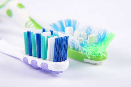 Used and replacement new toothbrush bristles macro close up