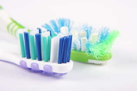 macro close up: Used and replacement new toothbrush bristles macro close up