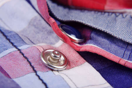 snap: Modern snap fastener button for clothing macro close up Stock Photo
