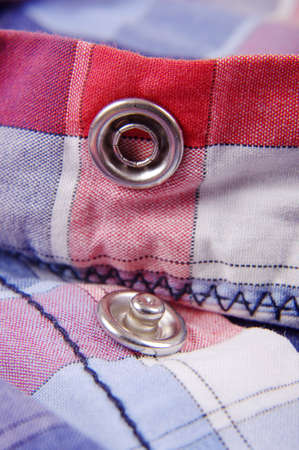 Modern snap fastener button for clothing macro close up Standard-Bild
