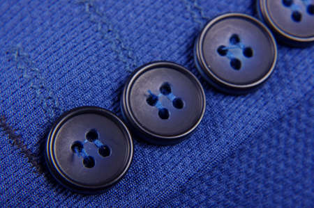 clothing buttons: Stylish clothing buttons macro close up