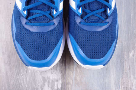 sneaks: Pair of sneakers isolated on the reclaimed wood background