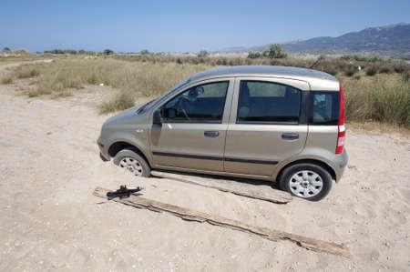 doomed: Car stuck in the sand in Kos island Greece
