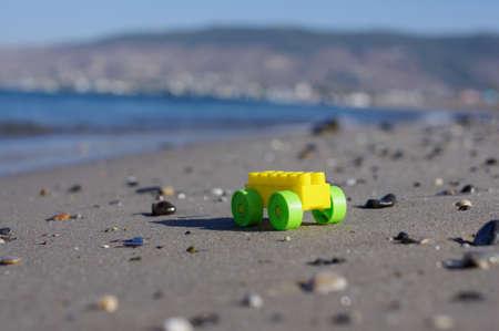 Baby toy car on the sandy beach