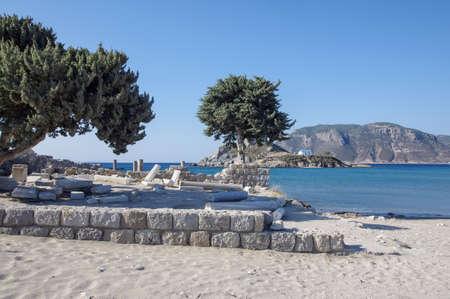 kos: Old ruins and sandy beach in front of Basilica of Ayios Stefanos, Kos island, Greece Stock Photo