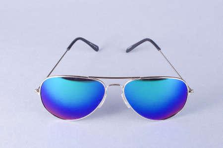 Stylish blue eye glasses isolated on the gray background Stock Photo