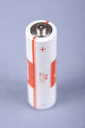 electrochemical: Disposable primary battery isolated on the gray background